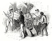 Hand-powered threshing machine by Barrett, Exall & Andrews.  These machines were more efficient than the traditional threshing with flails, the labour-intensive winter occupation of farm labourers. Engraving c1850.