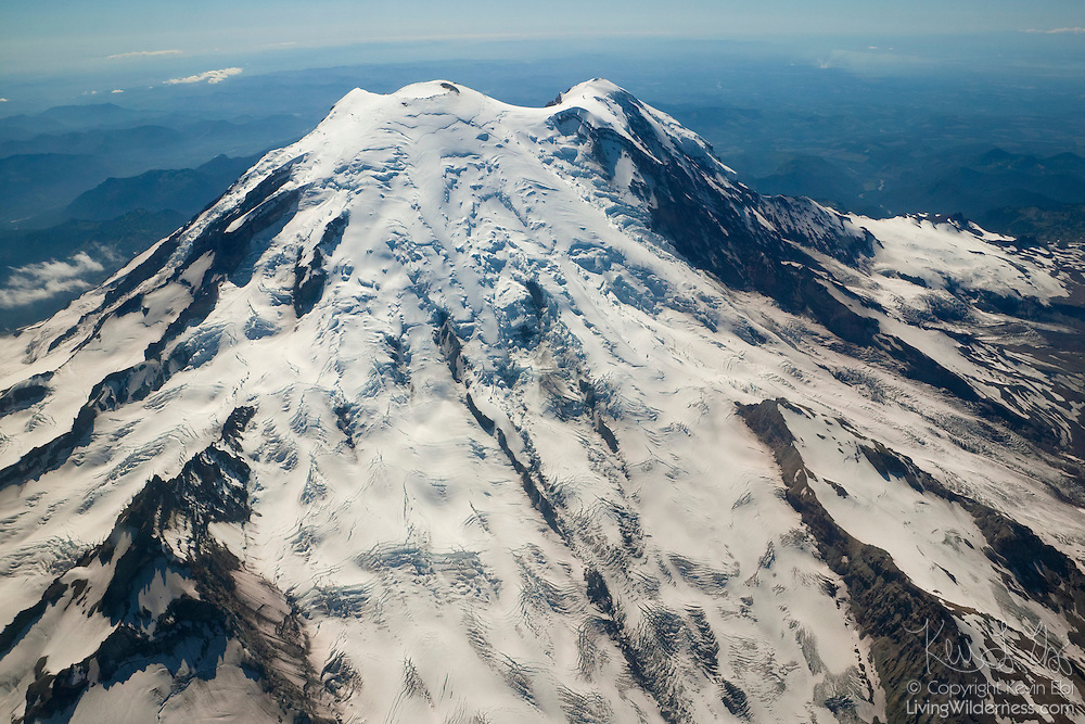 Several of Mount Rainier's glaciers are visible in this aerial view. The Emmons Glacier fills the bottom center of the frame. The Winthrop Glaicer, separated by a sharp rocky formation known as the Wedge, flows to the bottom-right of the frame. With 26 major glaciers covering 35 square miles, Mount Rainier is the most heavily glaciated peak in the 48 contiguous states in the US.