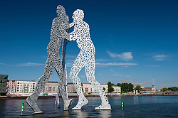 Huge Metallic sculpture called Molecule Man by Jonathan Borofsky in Spree River Berlin