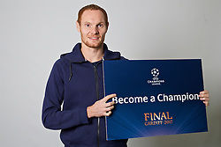 """CARDIFF, WALES - Monday, November 7, 2016: Wales' Shaun MacDonald holds up a board """"Become a Champion"""" to encourage people to become volunteers for the 2017 UEFA Champions League Final in Cardiff. (Pic by David Rawcliffe/Propaganda)"""