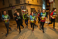 """People run on the 20th Korrika. Arketas (Basque Country). April 1, 2017. The """"Korrika"""" is a relay course, with a wooden baton that passes from hand to hand without interruption, organised every two years in a bid to promote the basque language. The Korrika runs over 11 days and 10 nights, crossing many Basque villages and cities. This year was the 20th edition and run more than 2500 Kilometres. Some people consider it an honour to carry the baton with the symbol of the Basques, """"buying"""" kilometres to support Basque language teaching. (Gari Garaialde / Bostok Photo)"""