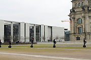 People ride Segways near the Reichstag building in Berlin, Germany, April 05, 2012.