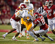 Nov 12, 2011; Fayetteville, AR, USA;  Tennessee Volunteers wide receiver Da'Rick Rogers (21) is brought down by linebacker Alonzo Highsmith (45) and cornerback Greg Gatson (28) as safety Tramain Thomas (5) and other defenders during a game at Donald W. Reynolds Razorback Stadium. Arkansas defeated Tennessee 49-7. Mandatory Credit: Beth Hall-US PRESSWIRE