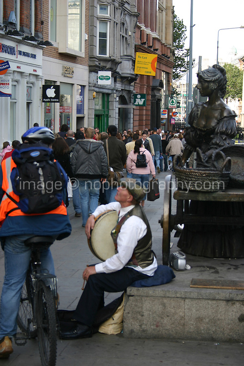 Busker at the Molly Malone statue Dublin Ireland<br />