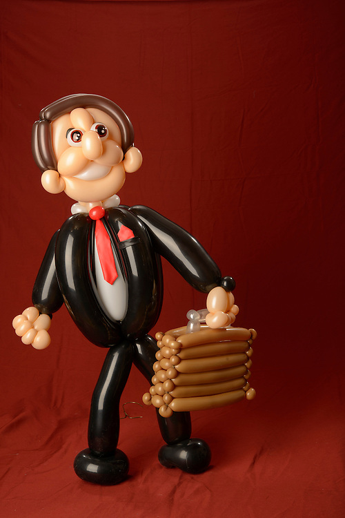 Photo by Matt Roth..A Balloon Sculpture of a Lawyer made by April Gomez in Baltimore, Maryland on Sunday, March 03, 2013