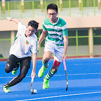 Player of RI in possession of the ball against a player from SJI. (Photo © Jerald Ang/Red Sports)
