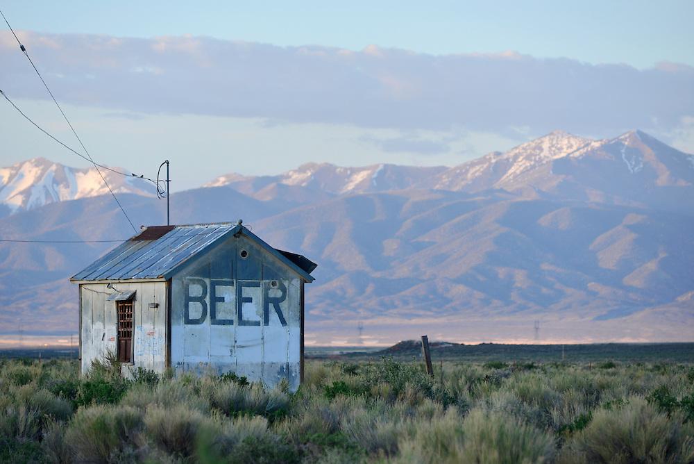 Beer ad on building in the Great Basin desert of Utah.