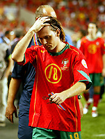 Fotball<br /> Euro 2004<br /> 04.07.2004<br /> Finale<br /> Hellas v Portugal<br /> Foto: SBI/Digitalsport<br /> NORWAY ONLY<br /> <br /> A dejected Maniche leaves the field