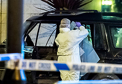 © Licensed to London News Pictures. 26/09/2018. Basildon, UK. Police forensics examine a vehicle at the scene at Basildon Hospital in Essex where a 19 year old male was take  after being shot in Tilbury earlier this evening. The male is being treated for a gunshot wound to the stomach and is currently in a serious condition. Photo Credit Simon Ford/LNP