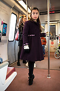 A little Irish step dancer warms up on the metro as she heads toward St Paddy's Day parade in down Washington, DC.