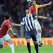 Galatasaray's Ayhan AKMAN (R) and Kasimpasaspor's Ersen MARTIN (C) during their Turkish Super League soccer match Galatasaray between Kasimpasaspor at the TT Arena at Seyrantepe in Istanbul Turkey on Monday 09 May 2011. Photo by TURKPIX