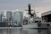 HMS Argyll, the longest-serving Type 23 Frigate in the Royal Navy, is pictured moored alongside ExCeL London against a backdrop of Canary Wharf in advance of the DSEI 2021 arms fair on 12th September 2021 in London, United Kingdom. Activists from a range of different groups continue to protest outside the venue for one of the worlds largest arms fairs.