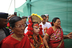 September 6, 2017 - Kathmandu, Nepal - Goddess 'Kumari' living goddess of Kathmandu walks towards chariot for the chariot pulling festival on the fourth day of Indra Jatra Festival celebrated at Basantapur Durbar Square, Kathmandu, Nepal on Wednesday, September 06, 2017. Devotees celebrated the god of rain 'Indra' for 8 days in Kathmandu.  Indra Jatra is one of the important festivals of Nepal celebrating the end of the monsoon.The biggest festival when Kumari shows up in the public is in Indra Jatra. On the following day the chariot of Kumari, Bhairab and Ganesh pulled around the streets of Basantapur Durbar Square, Kathmandu, Nepal. the living goddess Kumari is taken out in a procession in a chariot. The festival continues for eight days during which time there is much rejoicing, dancing and feasting. (Credit Image: © Narayan Maharjan/NurPhoto via ZUMA Press)
