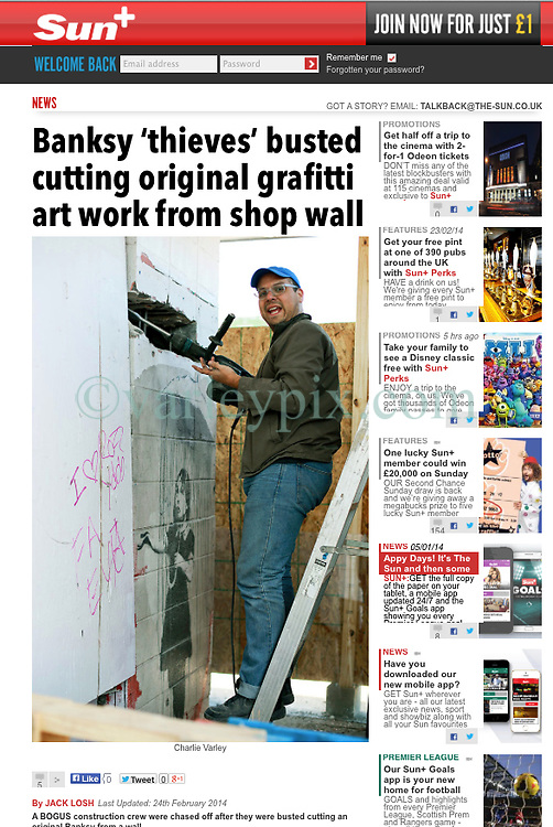 "24 February 2014. New Orleans, Louisiana.<br /> <br /> As reported in The Sun, London.<br /> <br /> Banksy 'thieves' busted cutting original grafitti art work from shop wall<br /> <br /> By JACK LOSH<br /> Last Updated: 24th February 2014<br /> <br /> A BOGUS construction crew were chased off after they were busted cutting an original Banksy from a wall.<br /> One of the gang, who called himself Chris, was caught holding a power drill half-way through extracting the work by the British street artist.<br /> <br /> Hidden by a temporary wall of plywood, he told snapper Charlie Varley that the 2008 artwork – dubbed ""Umbrella Girl"" – would be shipped to London for a Tate Modern retrospective of Banksy's career.<br /> He added that it would be re-installed at its current location on the side of an abandoned store in New Orleans, US, once the exhibition had finished.<br /> <br /> But when local residents quizzed the men and ordered them to show a permit for the operation, they packed up their equipment and scarpered.<br /> A security guard was installed at the scene on Friday to make sure the suspected thieves did not return.<br /> Clay Lapeyrouse, who lives nearby, said: ""They were cutting it out of the building. The story they gave me just seemed weird.""<br /> <br /> Police are now hunting the suspects, aged between 25 and 35, following the incident.<br /> Banksy's work fetches huge sums at auction, with his Kissing Coppers mural going under the hammer for £345,000 in the US last week.<br /> Photo; Charlie Varley/varleypix.com"