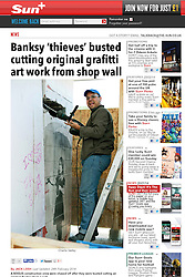 """24 February 2014. New Orleans, Louisiana.<br /> <br /> As reported in The Sun, London.<br /> <br /> Banksy 'thieves' busted cutting original grafitti art work from shop wall<br /> <br /> By JACK LOSH<br /> Last Updated: 24th February 2014<br /> <br /> A BOGUS construction crew were chased off after they were busted cutting an original Banksy from a wall.<br /> One of the gang, who called himself Chris, was caught holding a power drill half-way through extracting the work by the British street artist.<br /> <br /> Hidden by a temporary wall of plywood, he told snapper Charlie Varley that the 2008 artwork – dubbed """"Umbrella Girl"""" – would be shipped to London for a Tate Modern retrospective of Banksy's career.<br /> He added that it would be re-installed at its current location on the side of an abandoned store in New Orleans, US, once the exhibition had finished.<br /> <br /> But when local residents quizzed the men and ordered them to show a permit for the operation, they packed up their equipment and scarpered.<br /> A security guard was installed at the scene on Friday to make sure the suspected thieves did not return.<br /> Clay Lapeyrouse, who lives nearby, said: """"They were cutting it out of the building. The story they gave me just seemed weird.""""<br /> <br /> Police are now hunting the suspects, aged between 25 and 35, following the incident.<br /> Banksy's work fetches huge sums at auction, with his Kissing Coppers mural going under the hammer for £345,000 in the US last week.<br /> Photo; Charlie Varley/varleypix.com"""