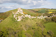 Corfe Castle is located in a natural defensive site on a hill between chalk ridges and for a thousand years has guarded the entry into the Isle of Purbeck.  The ruined state of the castle date from the English Civil War when it was twice held siege in the 1640s and subsequently largely demolished.