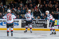 KELOWNA, CANADA - FEBRUARY 10: Nick Merkley #10 Nolan Foote #29 and Carsen Twarynski #18 of the Kelowna Rockets celebrate a goal against the Vancouver Giants on February 10, 2017 at Prospera Place in Kelowna, British Columbia, Canada.  (Photo by Marissa Baecker/Shoot the Breeze)  *** Local Caption ***