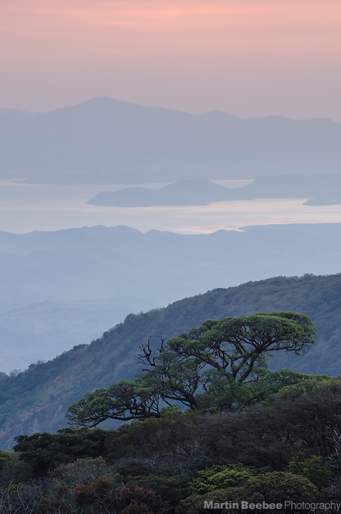 View of the Peninsula de Nicoya and Golfo de Nicoya from Monteverde at dusk, Costa Rica