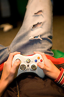 teenager playing on a video game in a youth club