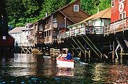 Alaska. Ketchikan. Creek Street and kayakers.