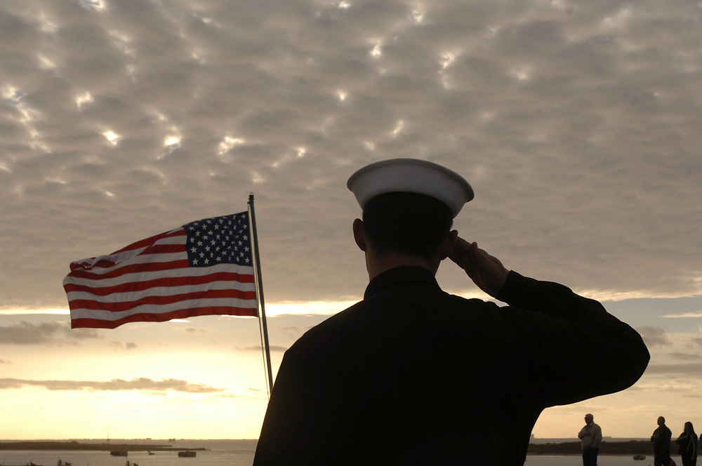 Port Aransas, TX January 15, 2006: Maiden voyage of the USS San Antonio (LPD-17) amphibious transport dock after her commissioning ceremony 14Jan.   Sailors salute the American flag during the morning playing of the National Anthem. ©Bob Daemmrich /