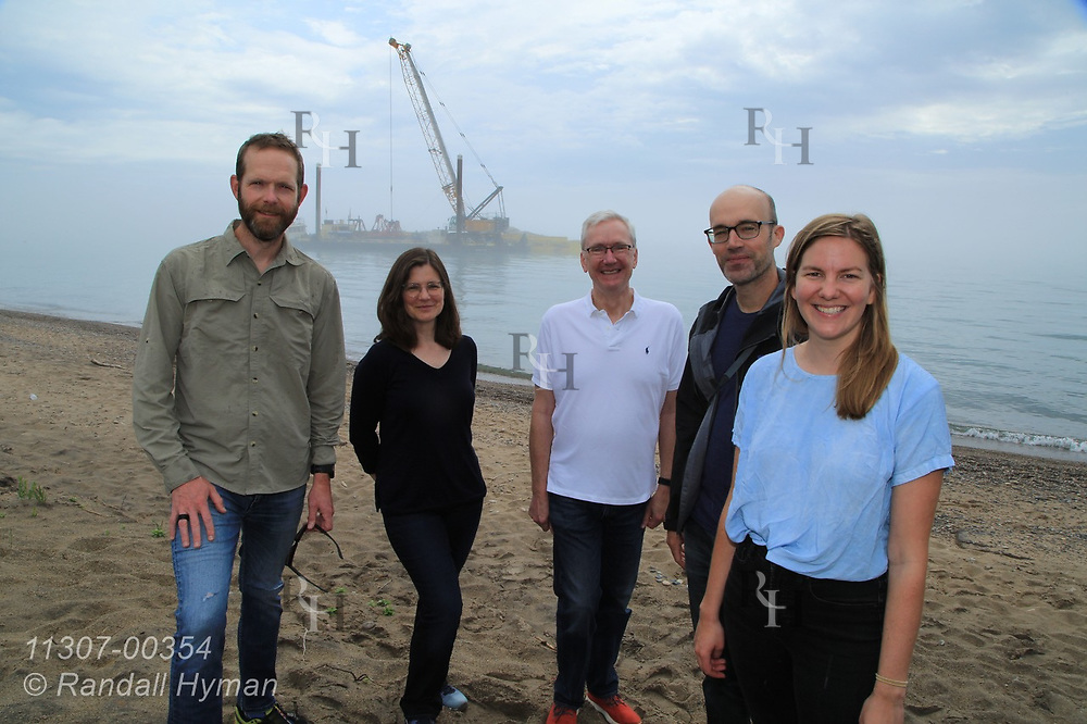 Healthy Ports landscape architecture profs Brian Davis (UVirginia) and Sean Burkholder (UPenn) pose with UPenn Lecturer Theresa Ruswick and GLPF's Amy Elledge and Steve Cole at Illinois Beach State Park as Army Corps team constructs underwater rubble ridge along shore; Zion, Illinois.