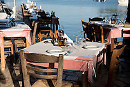 Taverna tables on a pier in Agios Stefanos, Corfu, The Ionian Islands, The Greek Islands, Greece, Europe