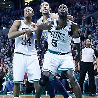 10 February 2013: Denver Nuggets center JaVale McGee (34) vies for the rebound with Boston Celtics power forward Kevin Garnett (5) and Boston Celtics small forward Paul Pierce (34) during the Boston Celtics 118-114 3OT victory over the Denver Nuggets at the TD Garden, Boston, Massachusetts, USA.