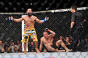 LAS VEGAS, NEVADA - NOVEMBER 16:  Johny Hendricks (L) reacts after the end of his fight with Georges St-Pierre in their UFC welterweight championship bout during the UFC 167 event at the MGM Grand Garden Arena on November 16, 2013 in Las Vegas, Nevada. (Photo by Jeff Bottari/Zuffa LLC/Zuffa LLC via Getty Images) *** Local Caption *** Johny Hendricks; Georges St-Pierre