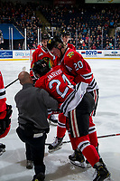 KELOWNA, CANADA - MARCH 3:  Portland Winterhawks' athletic therapist Rich Campbell tends to Seth Jarvis #24 on the ice after a check by the Kelowna Rockets on March 3, 2019 at Prospera Place in Kelowna, British Columbia, Canada.  (Photo by Marissa Baecker/Shoot the Breeze)