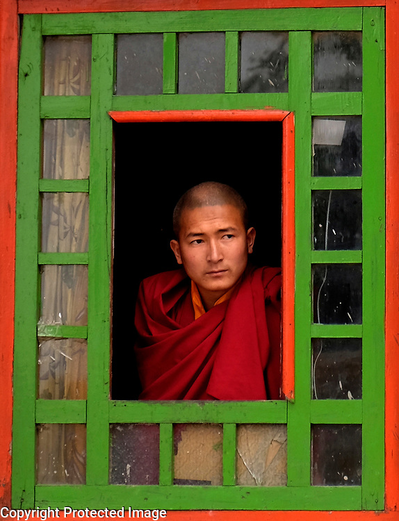 A Buddhist monk is framed by a window at the Rumtek Monestary outside of Gangtok, India on April 13, 2017.<br /> Photo by Shmuel Thaler <br /> shmuel_thaler@yahoo.com www.shmuelthaler.com