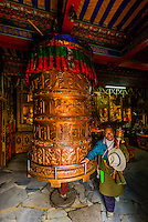 Prayer wheel near the Potala Palace, Lhasa, Tibet (Xizang), China.