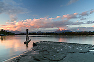 Sunset at Tavistock Point and the junction of the Fraser River and Bedford Channel at Brae Island Regional Park in Langley, British Columbia, Canada.  Mount Blanshard (The Golden Ears) is in the background.
