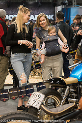 Anastasia Kostina with her baby Tasia and close friend Natasha Khirtrova at the Custom and Tuning Show, the custom bike show portion of the big Motor Spring bike show in Moscow, Russia. Saturday April 22, 2017. Photography ©2017 Michael Lichter.