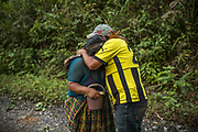 Two community members of Quejá are crying while remember what happened in their village.<br /> <br /> Central America is confronting a catastrophe: the mass destruction caused by two ferocious hurricanes that hit in quick succession in November pummeling the same fragile countries, twice. The storms, Eta and Iota, the most powerful in an already record breaking season, demolished tens of thousands of homes, wiped out infrastructure and swallowed vast swaths of cropland.<br /> <br /> Quejá village, San Cristobal Verapáz, Alta Verapáz, Guatemala. November 25, 2020