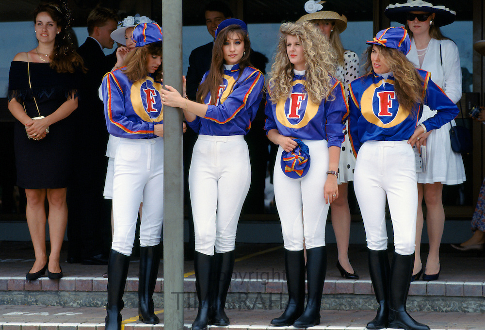Lady jockeys wearing Foster's Lager jockey silks at Melbourne Cup Races at Victoria Racing Club, Australia