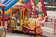 Dad and son riding train at Manufaktura providing entertainment culture and shopping. Balucki District Lodz Central Poland