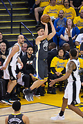 Golden State Warriors guard Klay Thompson (11) shoots a jump shot against the San Antonio Spurs during Game 2 of the Western Conference Quarterfinals at Oracle Arena in Oakland, Calif., on April 16, 2018. (Stan Olszewski/Special to S.F. Examiner)