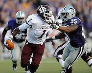 MANHATTAN, KS - OCTOBER 17:  Defensive end Jeffrey Fitzgerald #95 of the Kansas State Wildcats grabs quarterback Jerrod Johnson #1 of the Texas A&M Aggies for a sack in the first quarter on October 17, 2009 at Bill Snyder Family Stadium in Manhattan, Kansas.  (Photo by Peter G. Aiken/Getty Images)