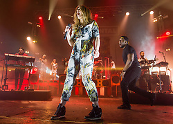 © Licensed to London News Pictures. 15/02/2014. London, UK.   Rudimental performing live at Brixton Academy. In this picture - Anne-Marie Nicholson (centre), DJ Locksmith (right).  Rudimental are an English electronic music quartet consisting of members Piers Agget,Kesi Dryden, Amir Amor,DJ Locksmith.    Photo credit : Richard Isaac/LNP