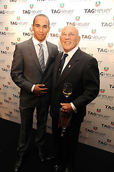 Left to right, LEWIS HAMILTON and SIR STIRLING MOSS at the TAG Heuer British Formula 1 Party at the Mall Galleries, London on 15th September 2008.