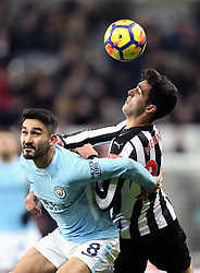 Manchester City's Ilkay Gundogan (left) and Newcastle United's Mikel Merino (right) battle for the ball during the Premier League match at St James' Park, Newcastle.