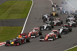 October 9, 2016 - Suzuka, Japan - Motorsports: FIA Formula One World Championship 2016, Grand Prix of Japan, .#3 Daniel Ricciardo (AUS, Red Bull Racing), #5 Sebastian Vettel (GER, Scuderia Ferrari), #7 Kimi Raikkonen (FIN, Scuderia Ferrari), #27 Nico Hulkenberg (GER, Sahara Force India F1 Team), #44 Lewis Hamilton (GBR, Mercedes AMG Petronas Formula One Team), .start, mass, Masse, Menge, viele, many  (Credit Image: © Hoch Zwei via ZUMA Wire)