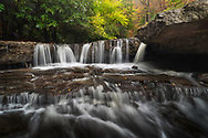 Mash Fork Falls flows below the drapery of autumn foliage in Camp Creek State Park, West Virginia