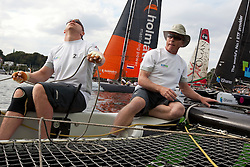 """© Sander van der Borch. Kiel - Germany, 27th of August 2009. iShares cup. Practice day...The first day of racing as part of the media day. the teams practice on the inland canal close to the city centre. Onboard the extreme 40 """"Ecover"""" with skipper and helmsman Mike Golding.."""