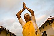 Pattu salutes the sun at dawn at the Tamaraikulum Elders village, Tamil Nadu, India