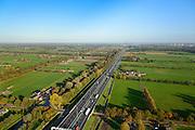 Nederland, Gelderland, Veendendaal, 24-10-2013. Autosnelweg A12 tussen  Veenendaal en Maarsbergen op een mooie herfstdag. <br /> Motorway A12 near Veenendaal, central Netherlands on a sunny day in autumn.<br /> luchtfoto (toeslag op standaard tarieven);<br /> aerial photo (additional fee required);<br /> copyright foto/photo Siebe Swart.
