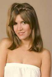 December 27, 2016 - File - CARRIE FRANCES FISHER (October 21, 1956 - December 27, 2016) was an American actress, screenwriter, author, producer, and speaker. She was known for playing Princess Leia in the Star Wars films. Fisher was also known for her semi-autobiographical novels, including Postcards from the Edge, and the screenplay for the film of the same name, as well as her autobiographical one-woman play, and its nonfiction book, Wishful Drinking, based on the show. Her other film roles included Shampoo (1975), The Blues Brothers (1980), Hannah and Her Sisters (1986), The 'Burbs (1989), and When Harry Met Sally (1989). Pictured: 1980's - New York, New York, U.S. - Carrie Fisher (Credit Image: © Lynn Goldsmith via ZUMA Press)