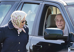 **2018 Pictures of the year by London News Pictures**<br /> © Licensed to London News Pictures. 11/05/2018. Windsor, UK. The Duke of Edinburgh is seen in a car talking to Queen Elizabeth II at the 75th Royal Windsor Horse Show . This is the first time the Duke has been seen since his hip operation last month. The five day event takes place in the grounds of Windsor Castle. Photo credit: Peter Macdiarmid/LNP