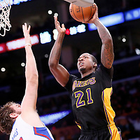 31 October 2014: Los Angeles Lakers forward Ed Davis (21) goes for the jumper over Los Angeles Clippers forward Spencer Hawes (10) during the Los Angeles Clippers 118-111 victory over the Los Angeles Lakers, at the Staples Center, Los Angeles, California, USA.